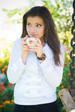 Young woman drinking tea Stock Images