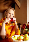 Young woman is drinking tea. Stock Photography