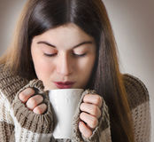 Young woman drinking tea Royalty Free Stock Photography