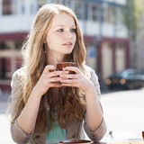 Young woman drinking tea Stock Photo