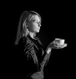Young woman drinking tea or coffee from a cup Royalty Free Stock Photos