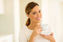Young woman drinking tea. Gorgeous young woman drinking tea at home Royalty Free Stock Image
