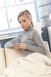 Young woman drinking tea at home Royalty Free Stock Photography