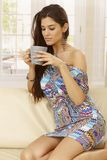 Young woman drinking tea at home Stock Photo