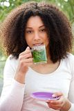 Young woman drinking tea outdoors Stock Photo