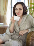 Young woman drinking tea at spa resort Royalty Free Stock Photography