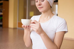 Young woman drinking tea after yoga Royalty Free Stock Images