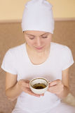 Young woman drinking tea after yoga Stock Photography