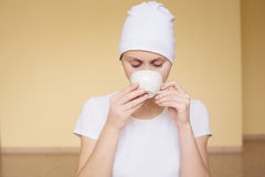 Young woman drinking tea after yoga Stock Image