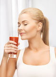 Young woman drinking tomato juice Royalty Free Stock Image