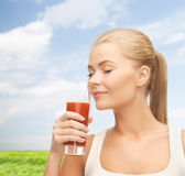 Young woman drinking tomato juice Stock Image
