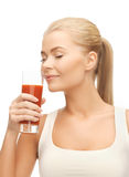 Young woman drinking tomato juice Royalty Free Stock Photography