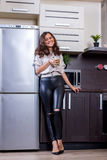 Young woman with drinking vegetable juice. In kitchen Stock Photos