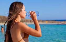A young woman is drinking a water Stock Image