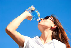 Young woman drinking water Stock Photo