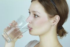 Young woman drinking water Royalty Free Stock Photo