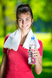 Young woman drinking water Stock Images