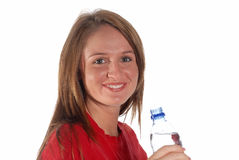 Young woman drinking water. Active young woman holding a bottle of water Stock Photos