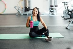 Young woman drinking water in gym, Stock Photos