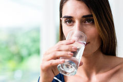 Young woman drinking water Stock Photos