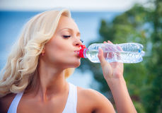 Young Woman Drinking Water After Jogging Royalty Free Stock Image