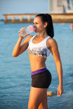 Young Woman Drinking Water After Jogging Stock Image