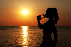 Young Woman Drinking Water After Jogging Royalty Free Stock Images