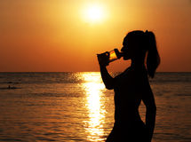 Young Woman Drinking Water After Jogging Royalty Free Stock Photography