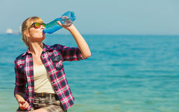 Young woman drinking water outdoor Stock Photos