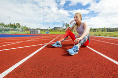 Young Woman Drinking Water and Rests On Running Tracks stock photos
