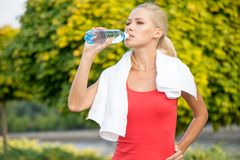 Young woman drinking water after running Royalty Free Stock Photography