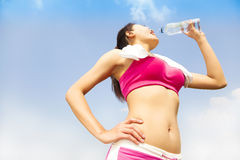 Young woman drinking water after running session Royalty Free Stock Photography
