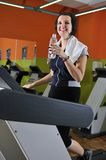 Young woman drinking water while working out Royalty Free Stock Photography