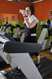 Young woman drinking water while working out Royalty Free Stock Image