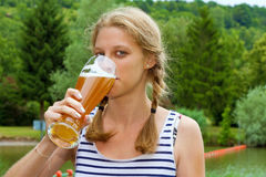 Young woman drinking a wheat beer Royalty Free Stock Images
