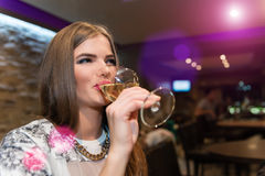 Young Woman Drinking White Wine Royalty Free Stock Photography