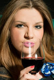 Young woman drinking wine Stock Image
