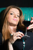Young woman drinking wine Royalty Free Stock Photo