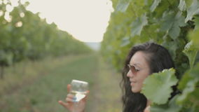 Young woman drinking wine stock footage