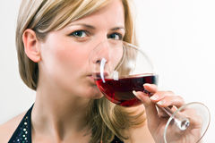 Young woman drinking wine Royalty Free Stock Photography