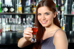 Young woman drinks cocktail Royalty Free Stock Photography