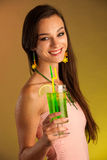 Young woman drinks a cocktail in night club Stock Photos