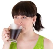The young woman drinks coffee Stock Photo