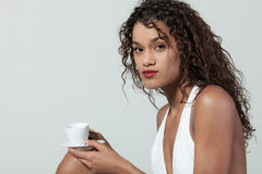 Young woman drinks a coffee Royalty Free Stock Images
