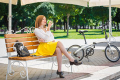 Young woman drinks coffee in the park Stock Photography