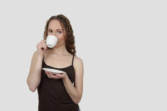 Young woman drinks coffee Stock Photos