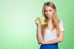 Young woman drinks coffee or tea Stock Photos