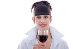 Young woman drinks a glass of red wine, on white Stock Photography