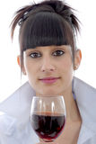 Young woman drinks a glass of red wine, on white Royalty Free Stock Photo