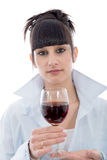 Young woman drinks a glass of red wine, on white Royalty Free Stock Photos